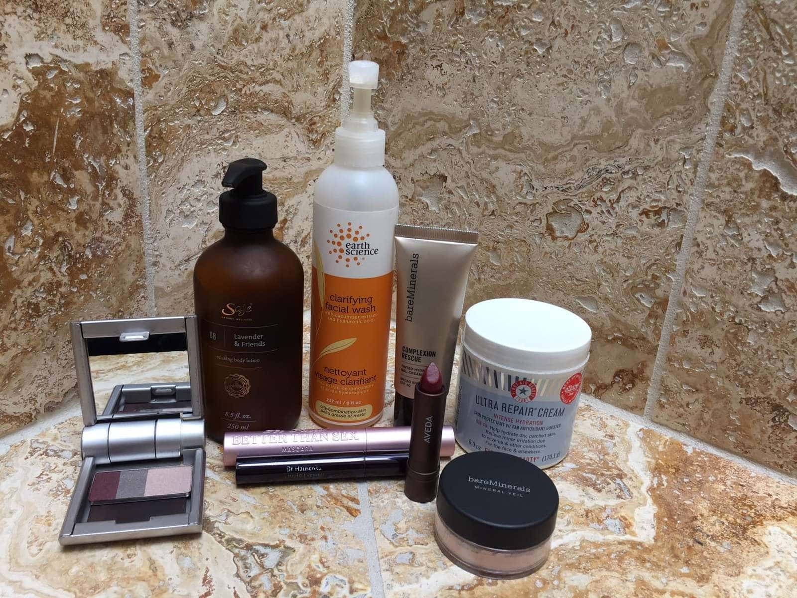 The beauty routine of Stella Carakasi. Photo depicts several bottles and jars of natural beauty skincare products on a counter.