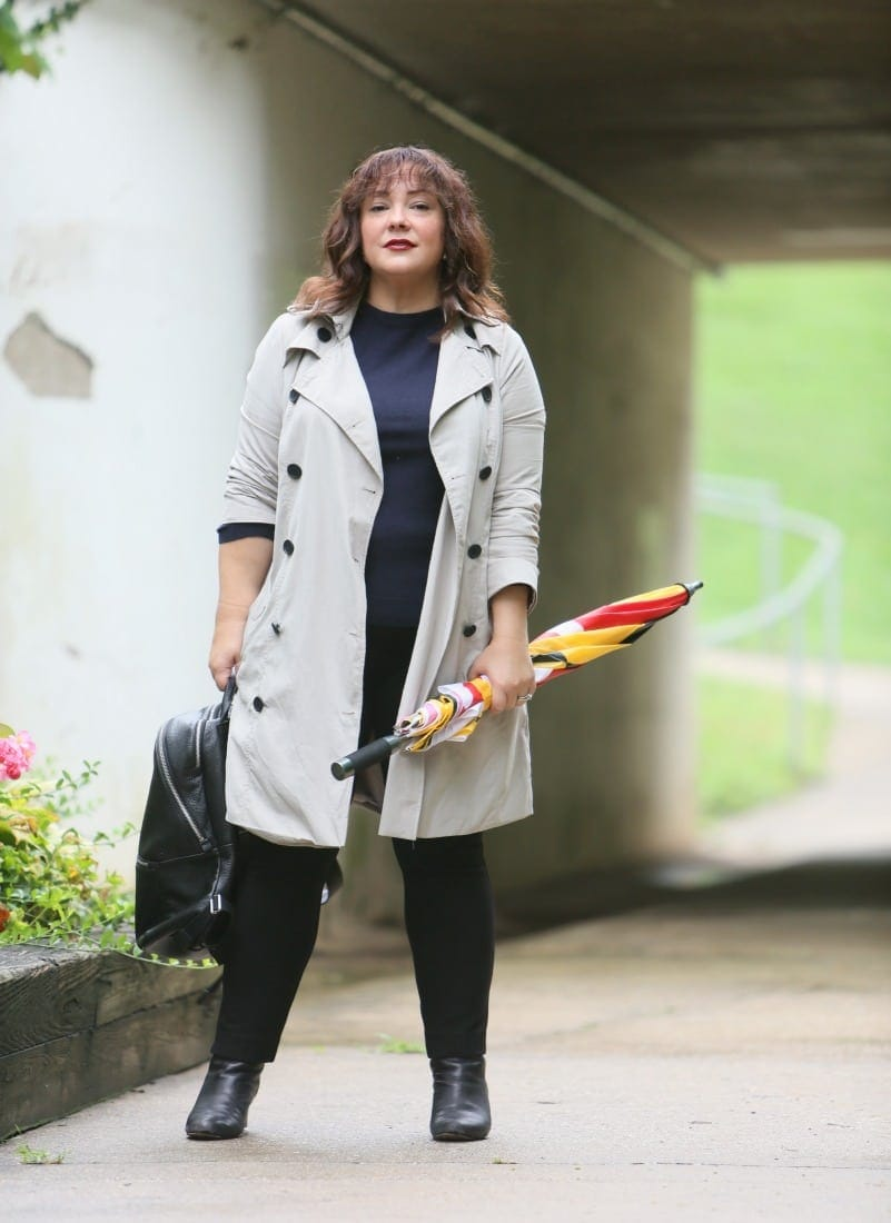 Alison Gary of Wardrobe Oxygen in a Universal Standard Trench Coat with Maryland Flag golf umbrella, navy Talbots cashmere sweater and black Chico's ponte pants