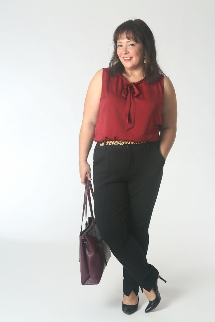The Cabi Cinch Blouse styled with black ponte pants and a leopard skinny belt