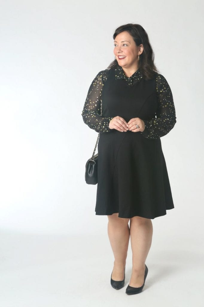 Wearing a sheer blouse under a ponte fit and flare dress.