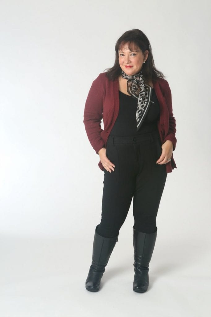 The cabi Catch Cardigan with the leopard scarf, black tank and pants, and black leather knee-high boots.