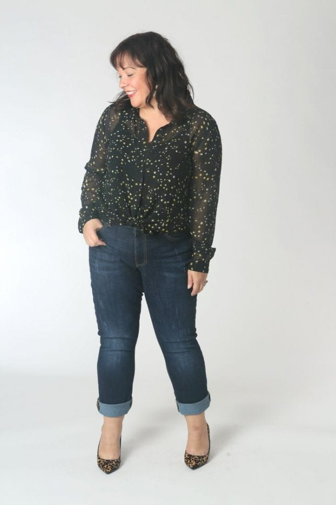 The cabi high straight jeans on a petite woman, hem cuffed