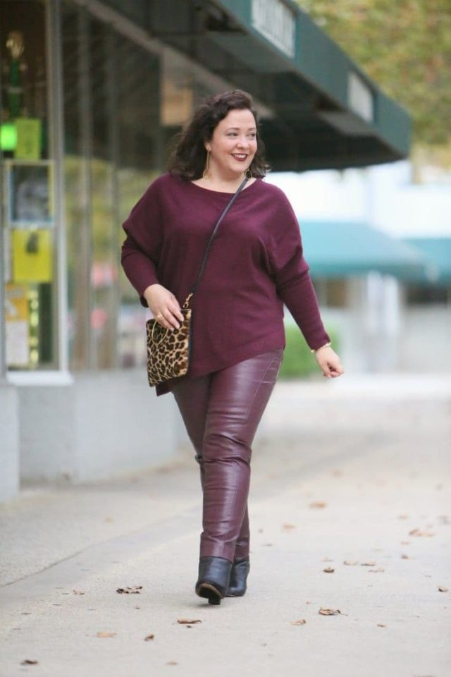 Merlot cashmere sweater and faux leather pants from Chico's and a Thacker NYC leopard ring handle bag on Wardrobe Oxygen