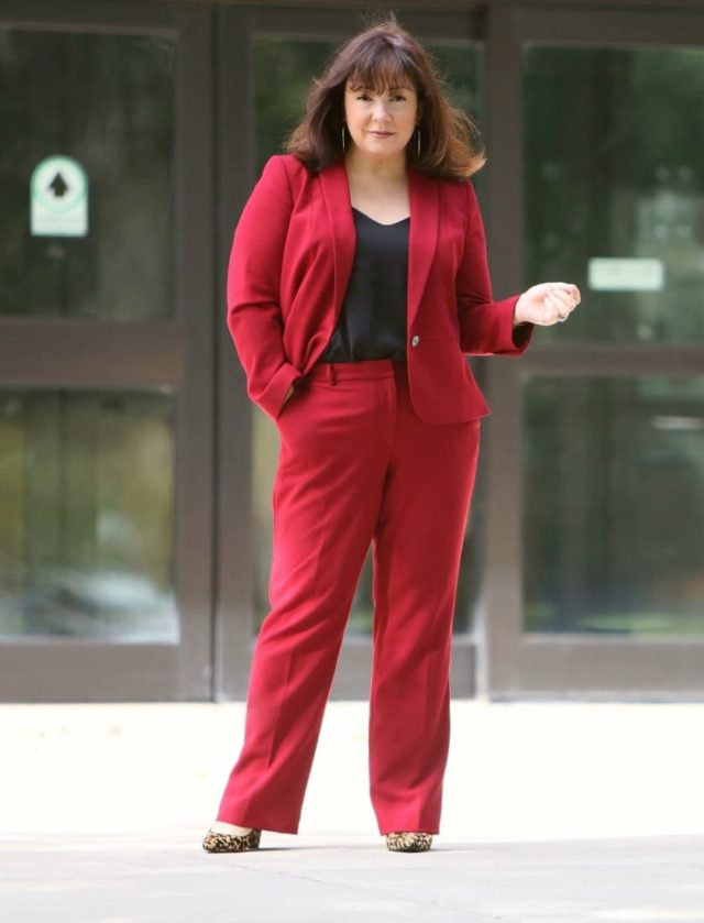 3616be47d13b3 Wardrobe Oxygen in a red pantsuit from Talbots styled with leopard block  heel pumps
