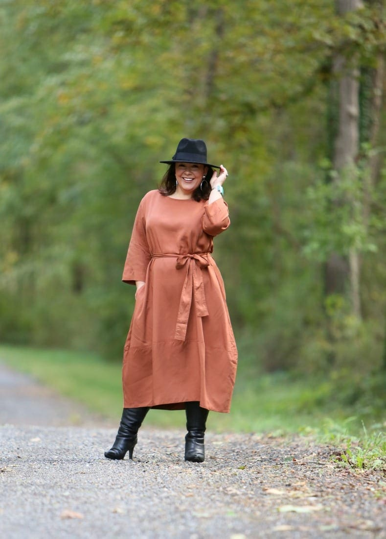 Wardrobe Oxygen in the And Comfort The Cambridge Tie Dress with Jenny Bird Factory Drop Earrings, an Ann Taylor black fedora and black heeled knee-high boots