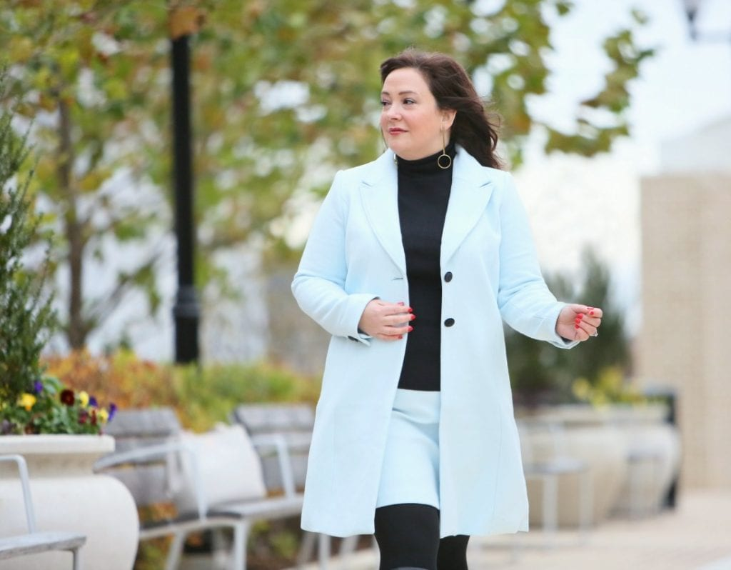 An ice blue skirt suit from White House Black Market styled with black boots and turtleneck as seen on Alison Gary of Wardrobe Oxygen
