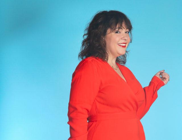 Alison Gary of Wardrobe Oxygen in a red wrap dress from Universal Standard