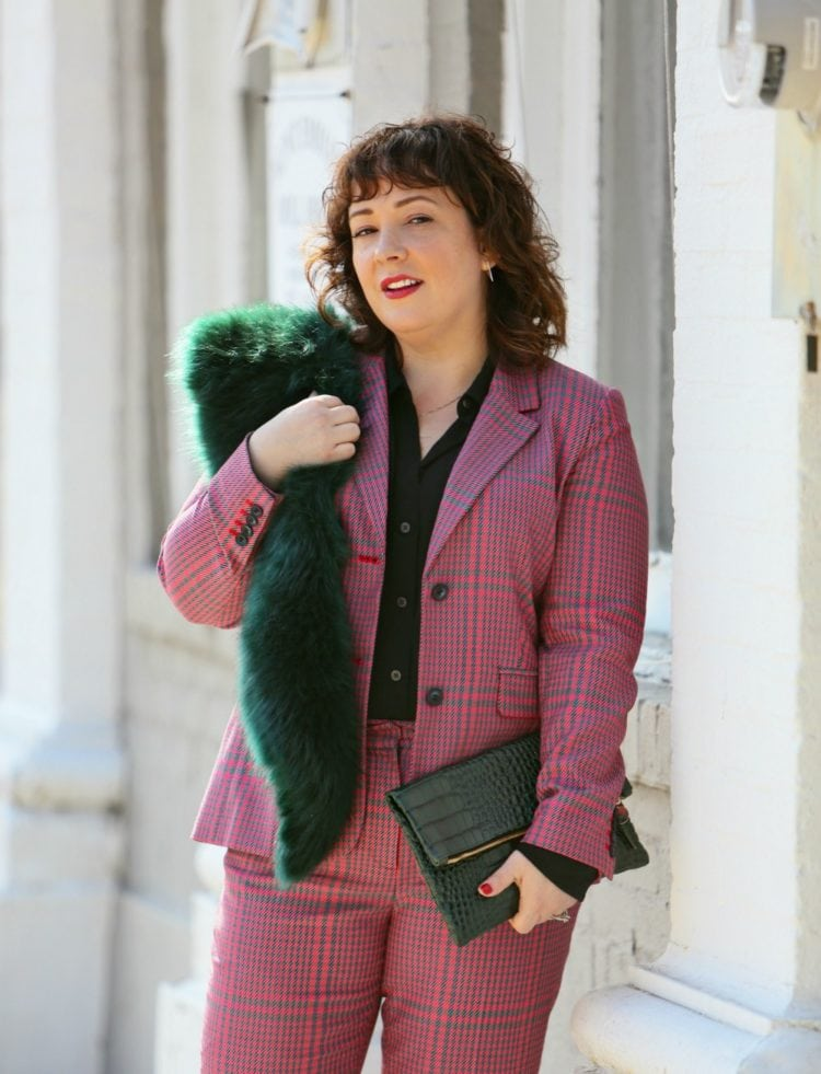 Wardrobe Oxygen in a pink plaid pantsuit from 1901 with a green faux fur stole and green Clare V. folder clutch