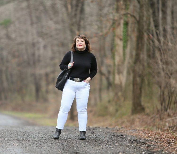 Black Coolmax turtleneck and white stain resistant jeans from Chico's styled on Wardrobe Oxygen with black Clarks ankle boots and the ALLSAINTS North/South totez