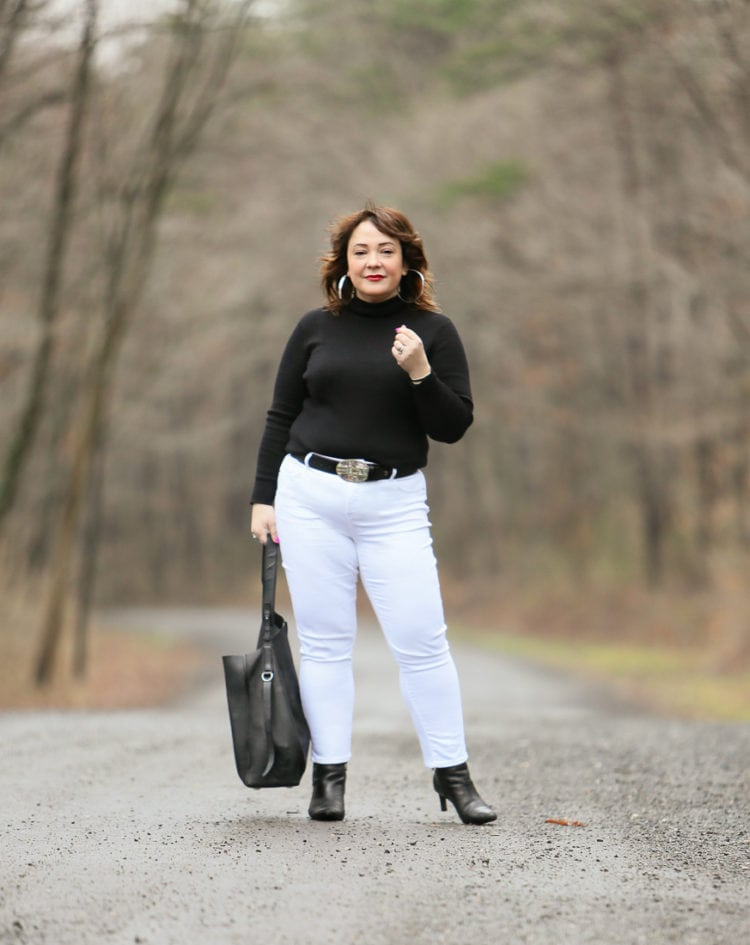 Black Coolmax turtleneck and white stain resistant jeans from Chico's styled on Wardrobe Oxygen with black Clarks ankle boots and the ALLSAINTS North/South tote