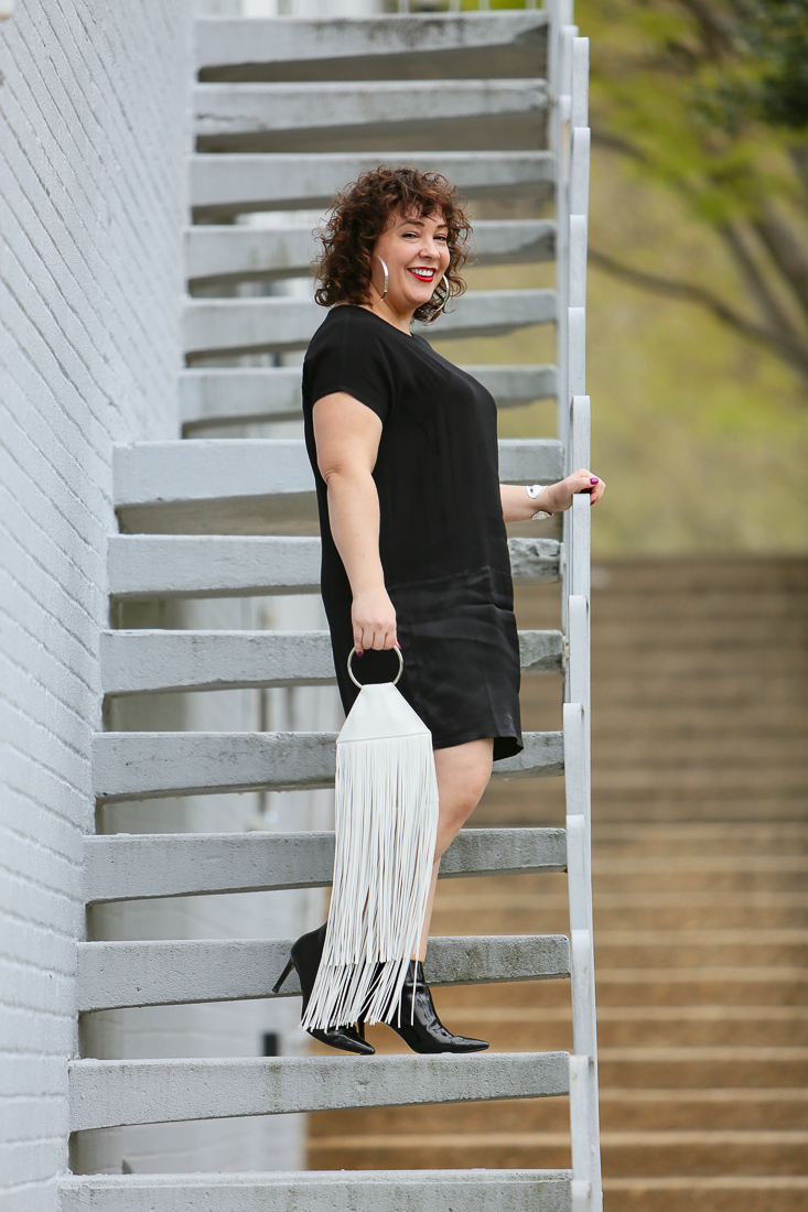 Wardrobe Oxygen in the Universal Standard Petite Avenir dress with a white fringe ring bag from KARA