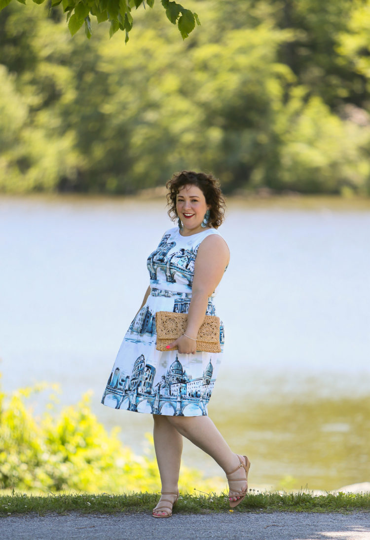 Rome-inspired printed fit and flare dress from Talbots styled with a woven straw clutch purse, Zara earrings, and Talbots wide width wedge sandals