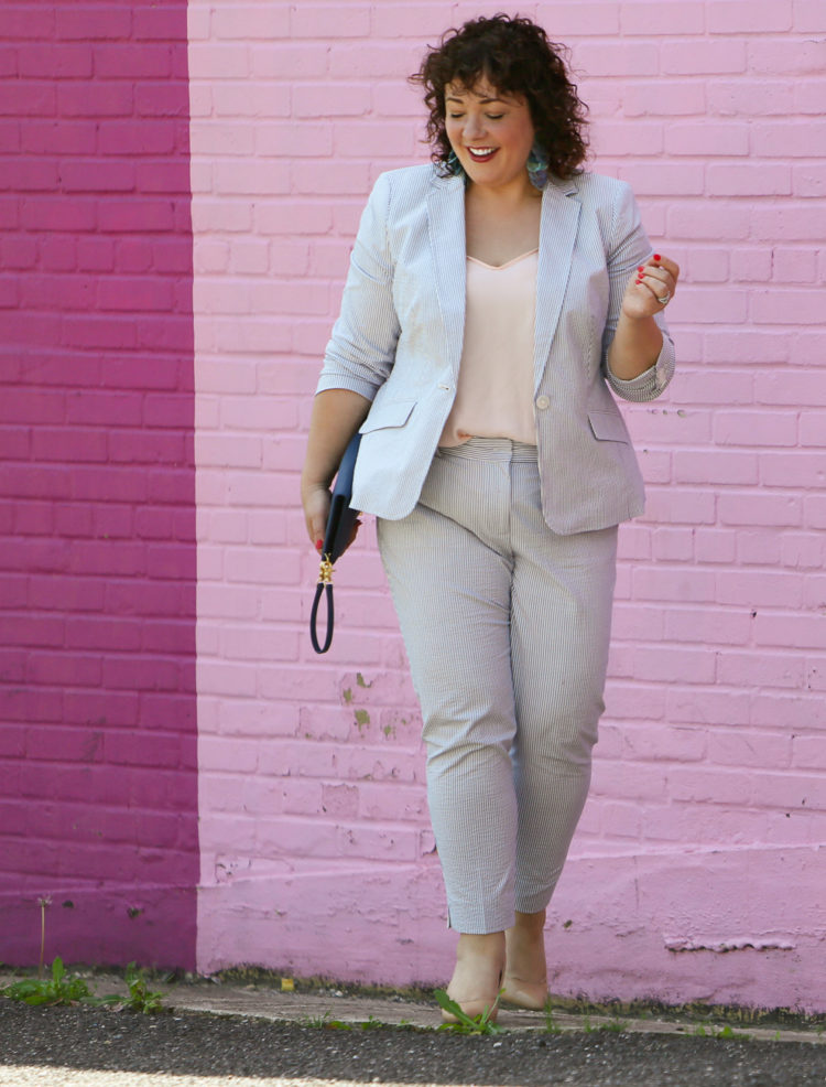 Wardrobe Oxygen in a seersucker pantsuit with blush J. Crew camisole, nude pumps from Nine West, and the Dagne Dover Essentials Clutch Wallet