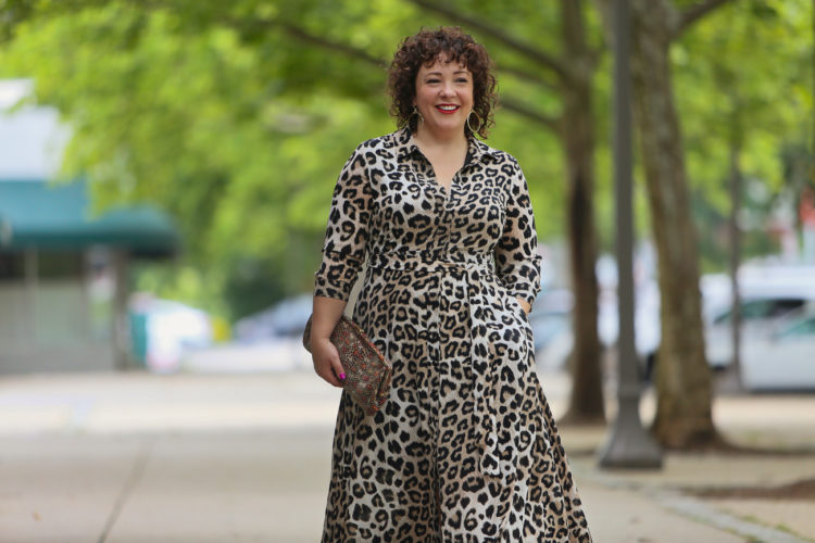image of Alison wearing a leopard print maxi dress and aviator sunglasses