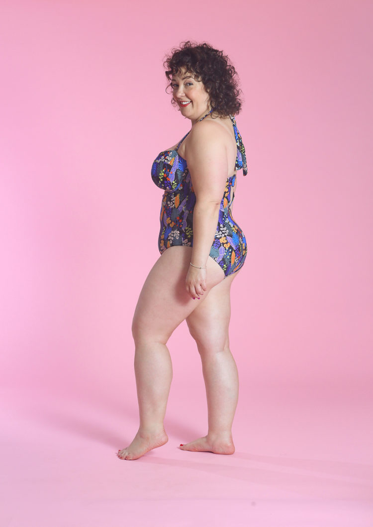 image of Wardrobe Oxygen wearing Santiago Floral Bandeau tummy control swimsuit from Figleaves