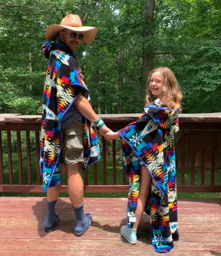 alison's husband and daughter standing on their patio wearing matching hooded Pendleton towels
