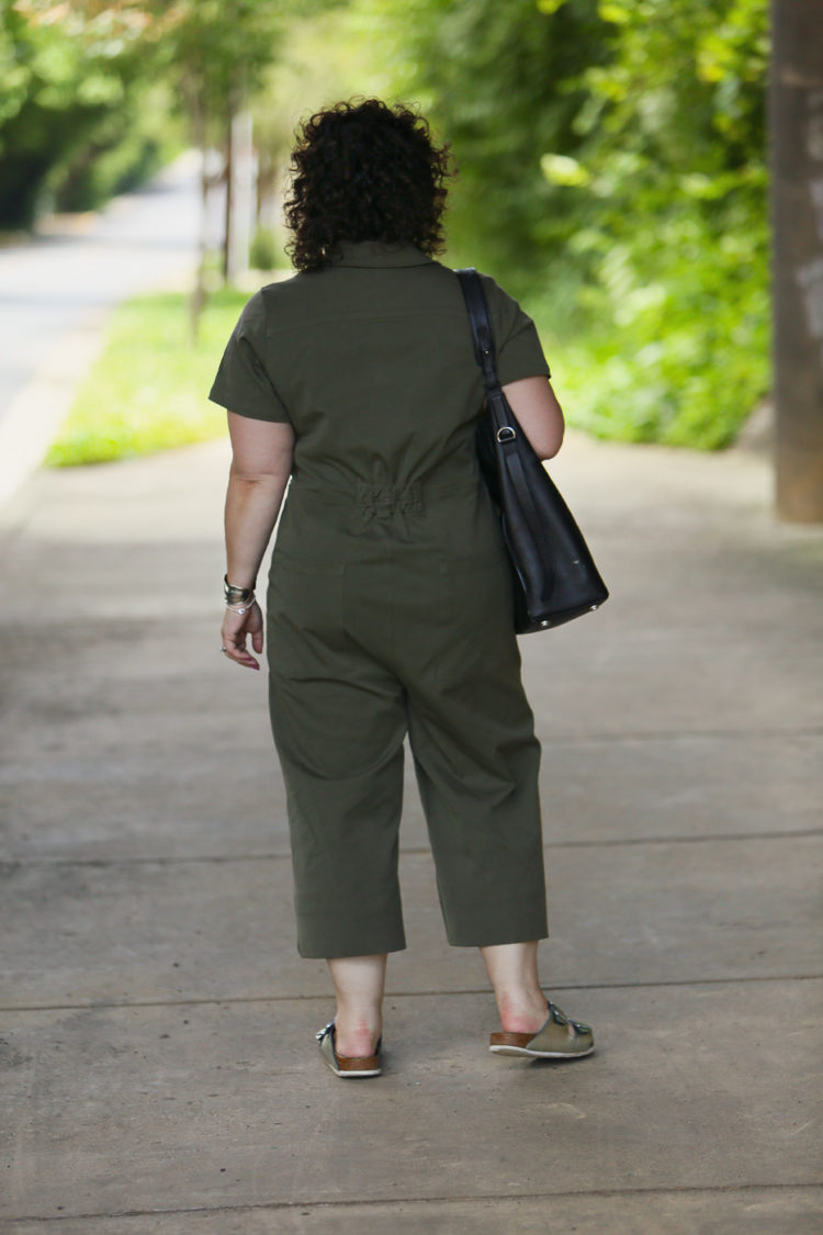 Wardrobe Oxygen in the Universal Standard Kate Twill Jumpsuit in green with silver Birkenstocks and the Jenny Bird Cober Hoops in Silver