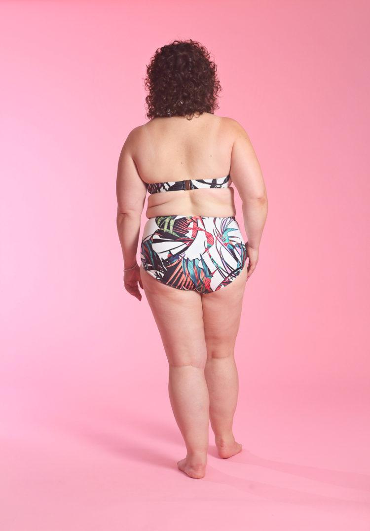 image of Wardrobe Oxygen wearing Bali Palm Underwire Bandeau bikini top from Figleaves and high waist tummy control bikini brief
