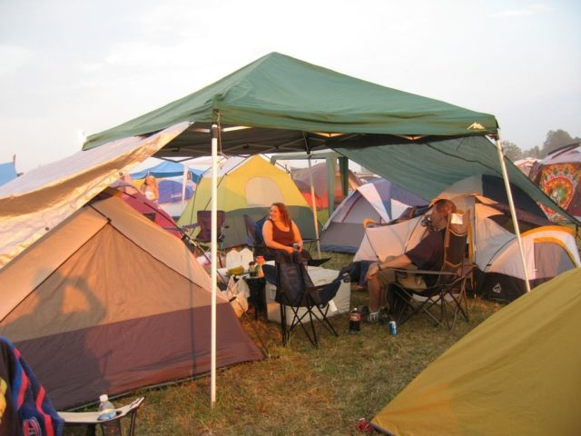 two tents connected by an EZ up shade shelter