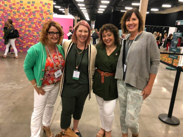 four women smiling together at the Hub at cabi Scoop 2019