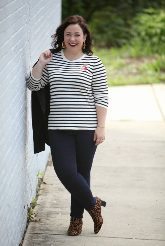 Alison in a black and white striped sweater with dark wash JAG jeans and leopard print ankle booties