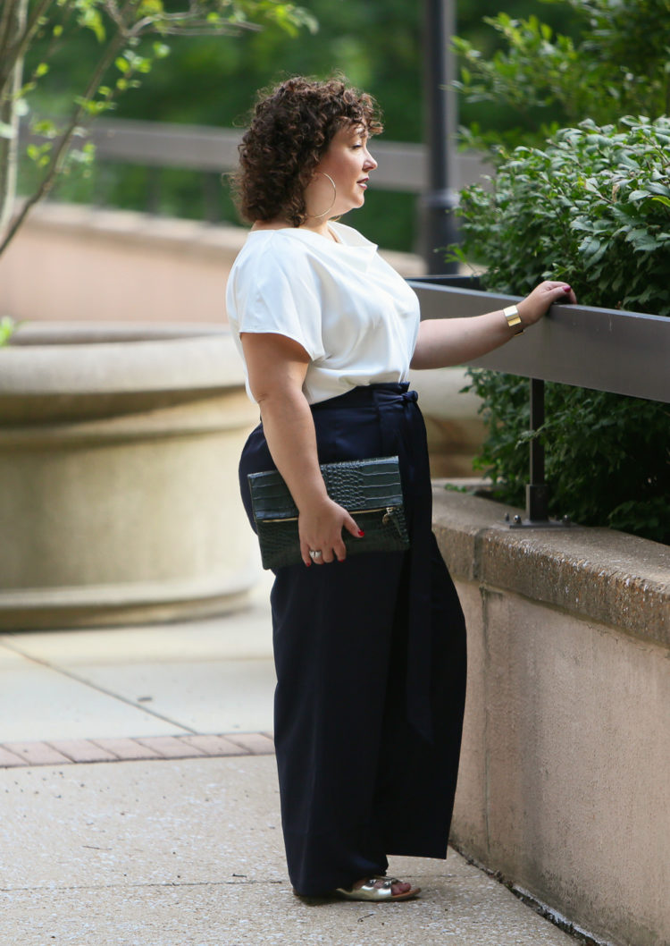 Wardrobe Oxygen in the Universal Standard Tresa Wide Leg pants and Viva Boatneck with Jenny Bird jewelry and a Clare V. Foldover Clutch