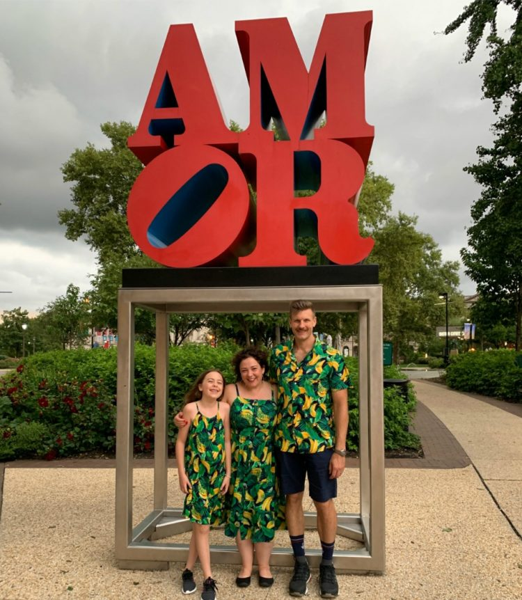 A family standing at the AMOR sculpture in Philadelphia