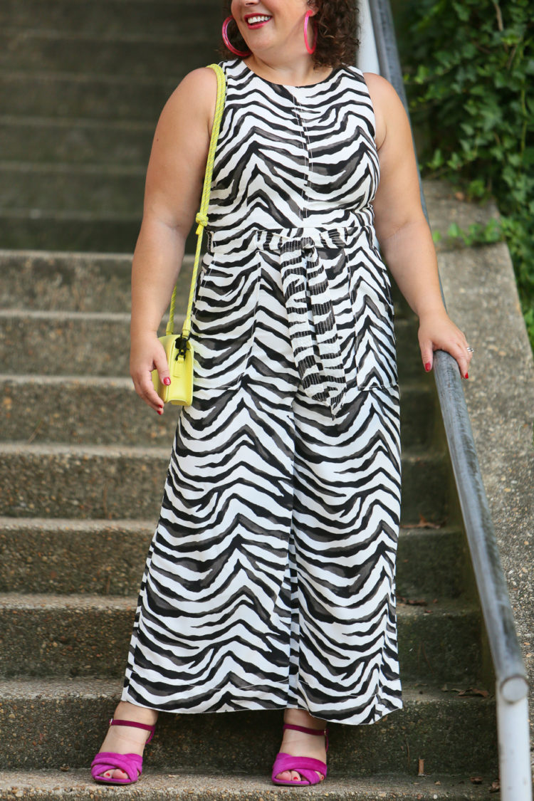 Wardrobe Oxygen in a zebra jumpsuit from Banana Republic with a highlighter yellow Dagne Dover bag and hot pink heels and BaubleBar lucite hoops