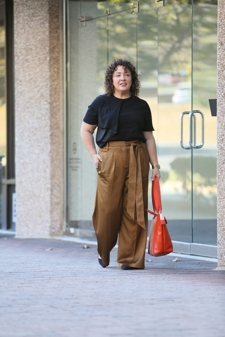 Wardrobe Oxygen in Universal Standard Abagail Top and Tresa Wide Leg Pants with a Clare V. Le Zip Sac Tote in orange