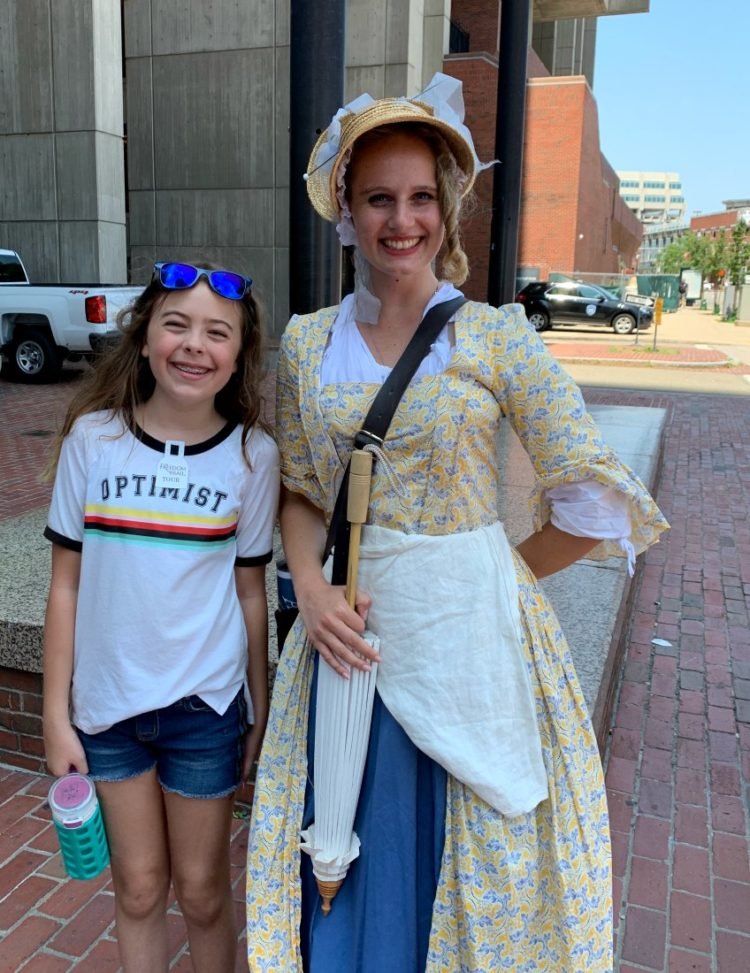 Emerson with a tour guide dressed in colonial garb