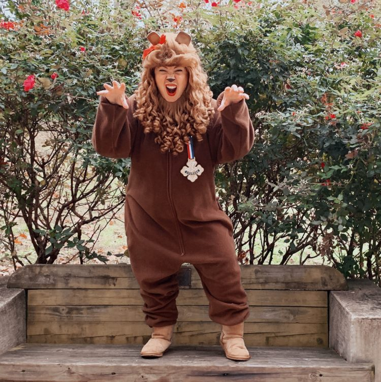 woman in a costume to be the cowardly lion from the wizard of oz