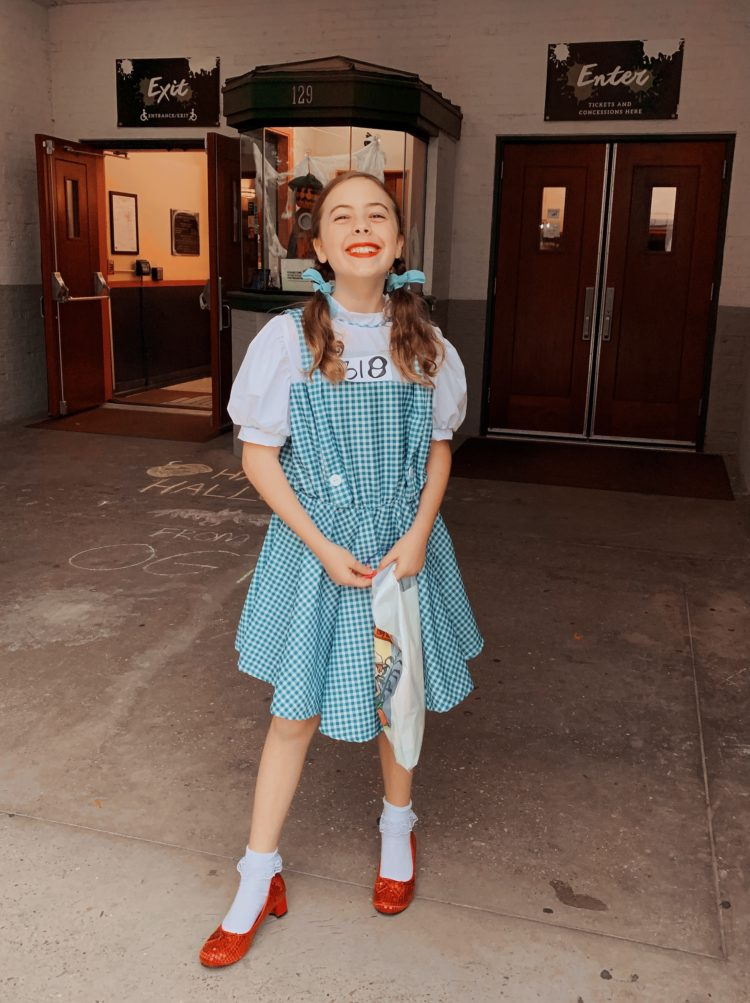 young girl dressed as Dorothy from the Wizard of Oz