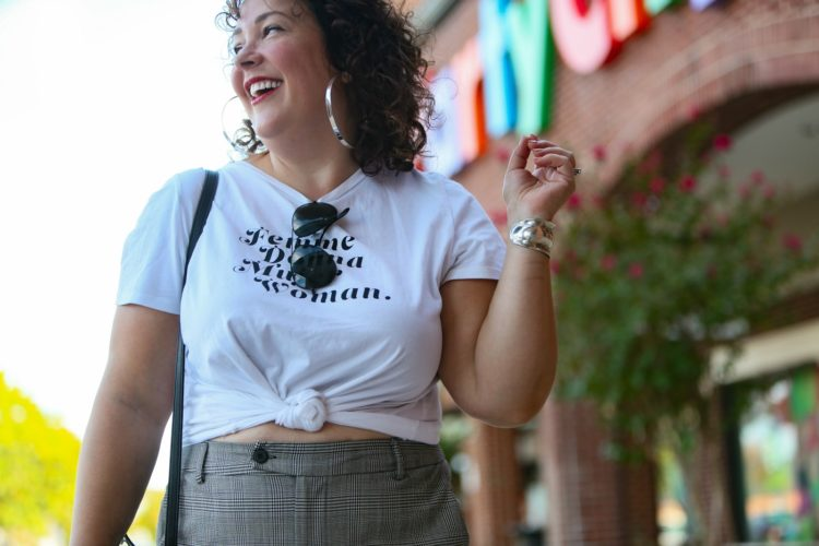 woman in white graphic t-shirt and plaid wide leg pants