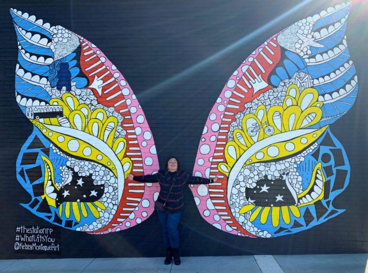 Wing mural in Riverdale Park, Maryland by muralist Kelsey Montague
