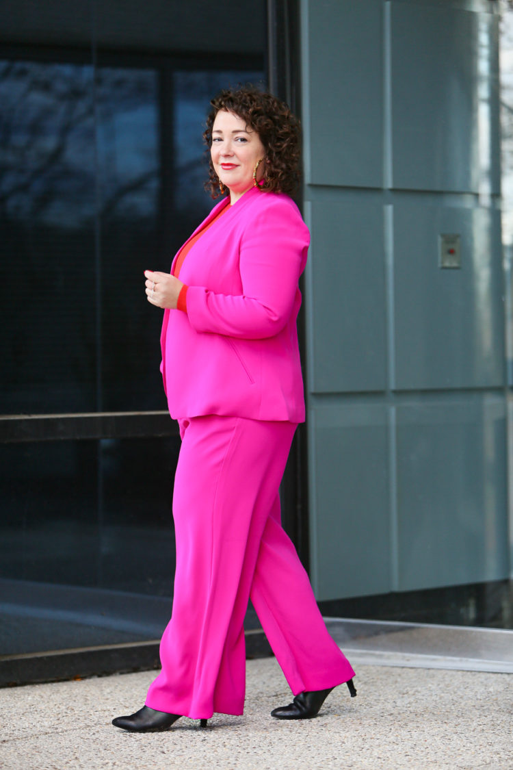 hot pink wide leg pantsuit from Banana Republic with an orange red merino wool crewneck sweater and leopard faux fur coat as seen on over 40 fashion blogger wardrobe oxygen