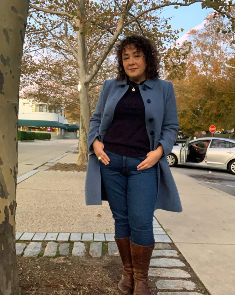 Wardrobe Oxygen in a blue wool lady coat and navy cashmere sweater both from Talbots with Everlane jeans and wide calf riding boots