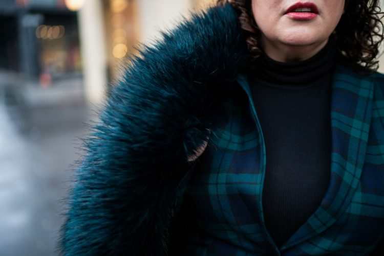 Styling a dark green faux fur coat from Unreal Fur with a green plaid pantsuit and black turtleneck