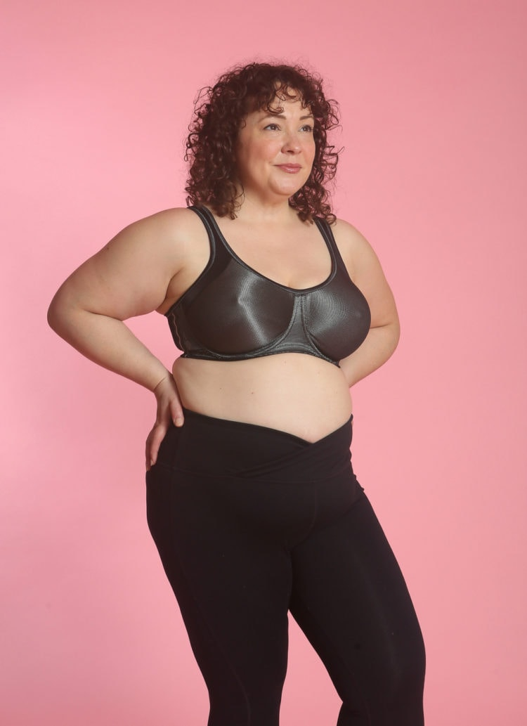 Alison wearing a silvery gray sports bra