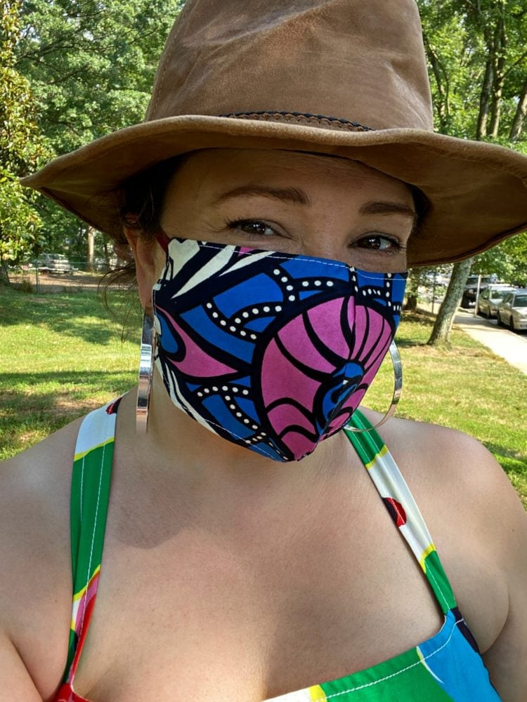 woman wearing a blue and hot pink printed cloth face mask from Kaela Kay