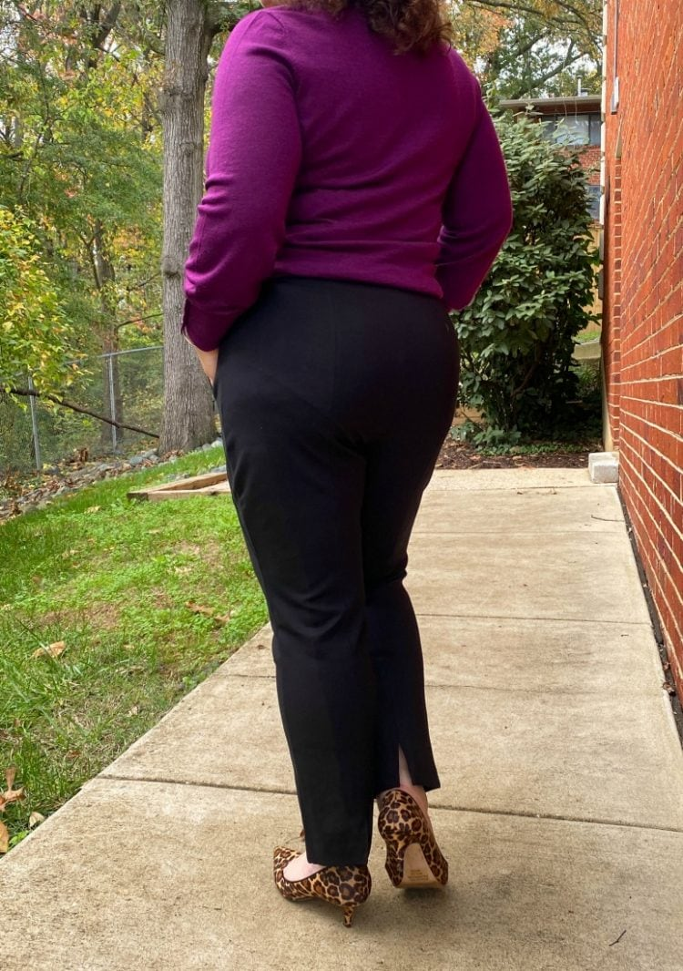 black ponte knit ankle pants as seen on a woman facing away from the camers