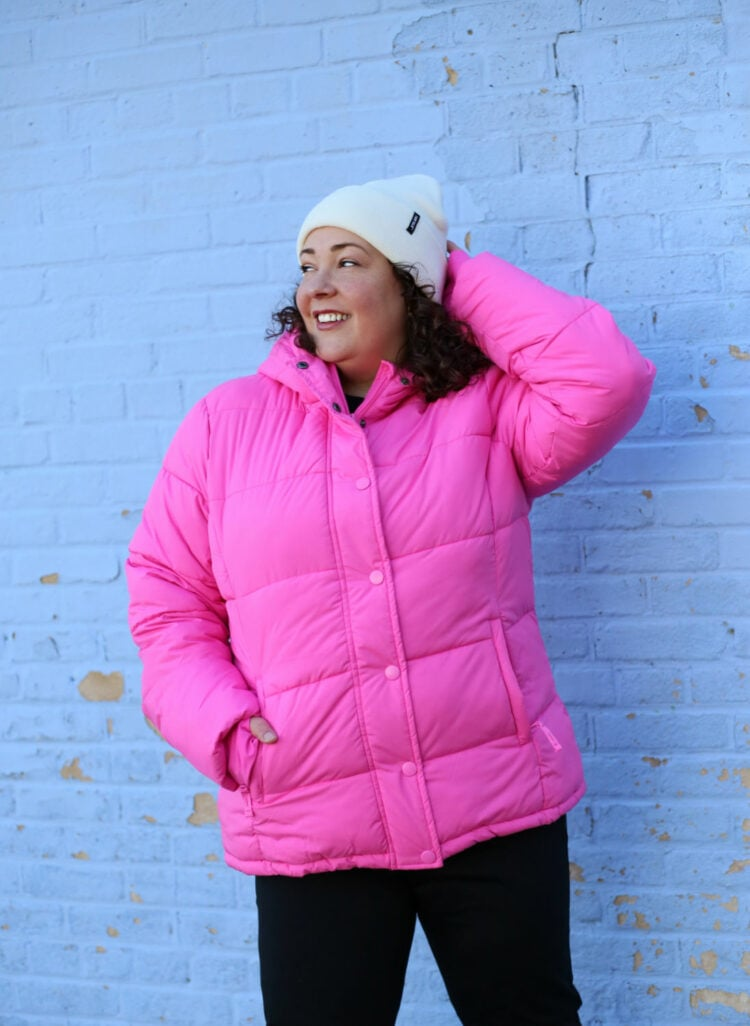 Wardrobe Oxygen in a pink puffer coat with hood from Amazon with a Furtalk beanie