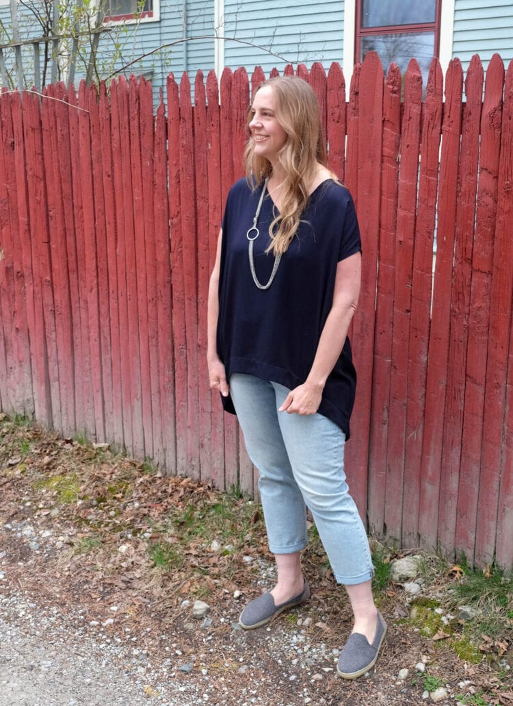 The Tiny Closet Tourist Tunic on Lissa, styled with faded ankle jeans and a long silver necklace