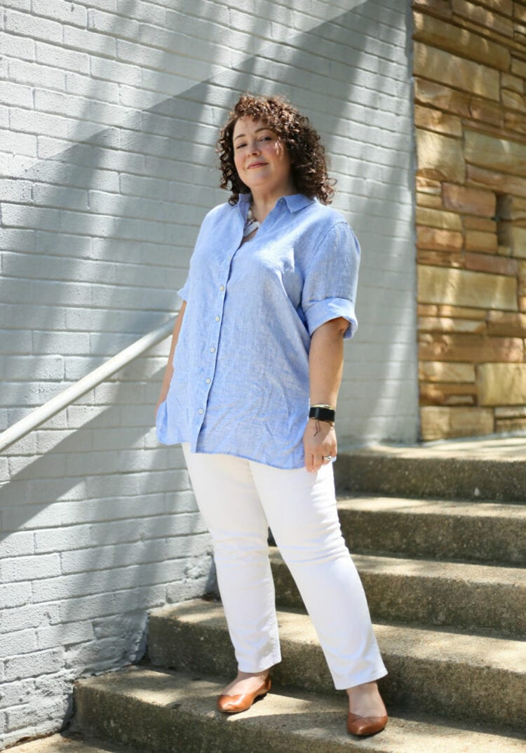 wrinkle-free linen tunic in light blue with white ankle jeans and brown pointed toe flats as seen on Alison