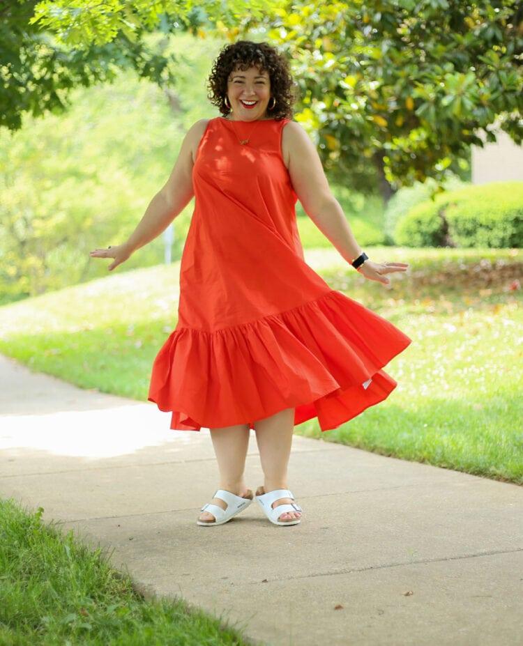 Alison spinning in the Christopher John Rogers for Target Orange Shift Dress