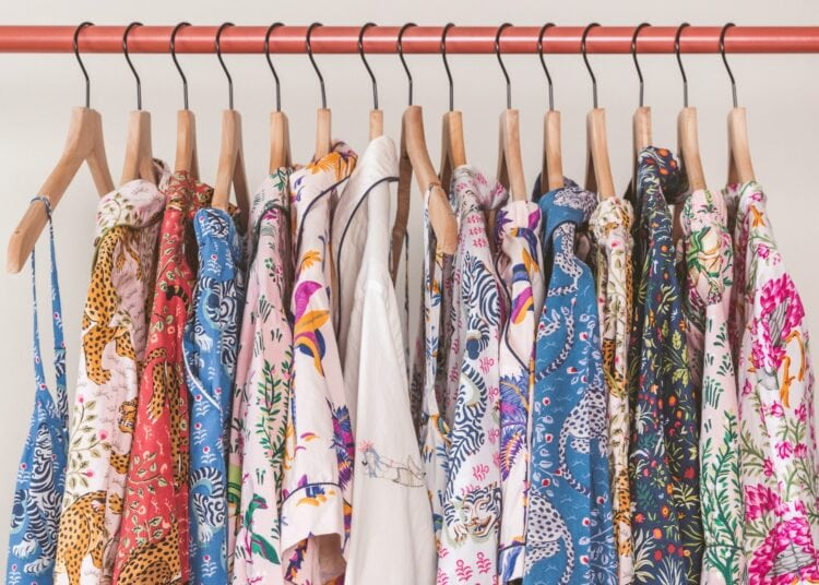 Printfresh review: image of Printfresh pajamas hanging in a row on a clothing rack