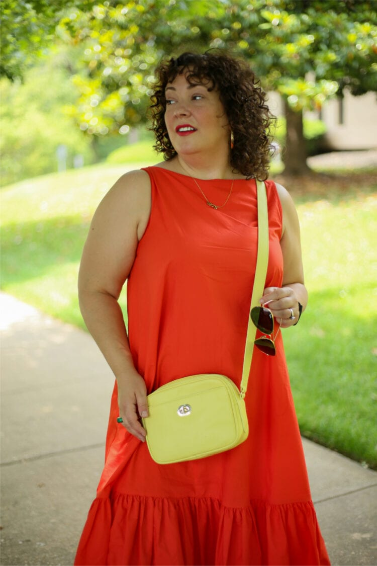 A closeup of the Talbots camera bag in lemon yellow that Alison is wearing as a crossbody
