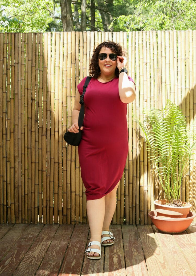 Universal Standard Geneva Dress in Berry with white Birkenstock Arizona sandals and a black belt bag worn as a shoulder bag as seen on Alison Gary of Wardrobe Oxygen