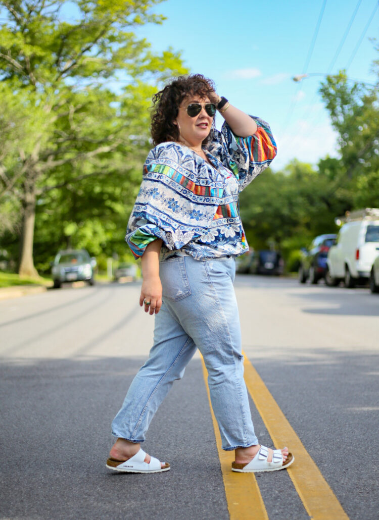 Wardrobe Oxygen in a Farm Rio blouse and Gap high rise cheeky straight jeans and white BIrkenstocks