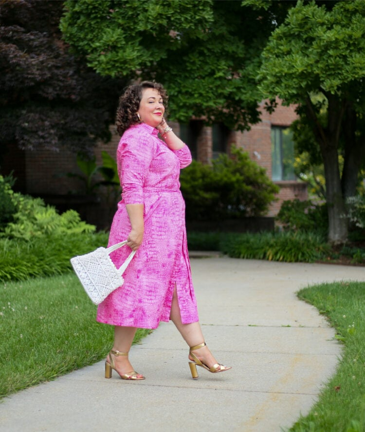 Alison of Wardrobe Oxygen in a pink poplin belted shirtdress from Chico's