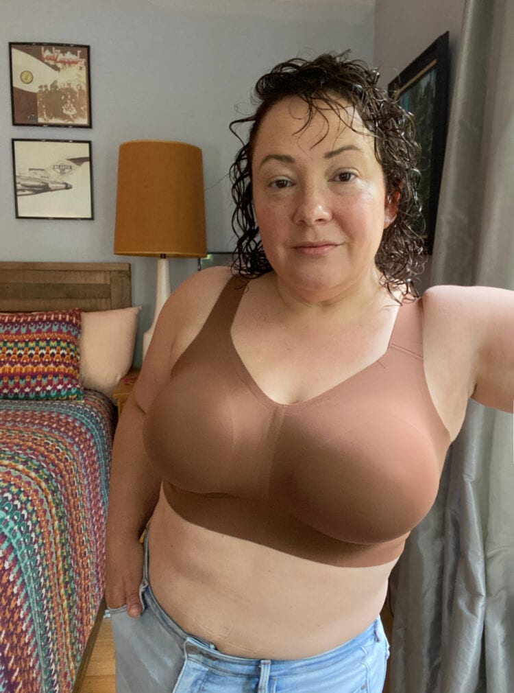 Evelyn & Bobbie Beyond bra review by Wardrobe Oxygen. She is wearing a brown wireless bra and looking at the camera